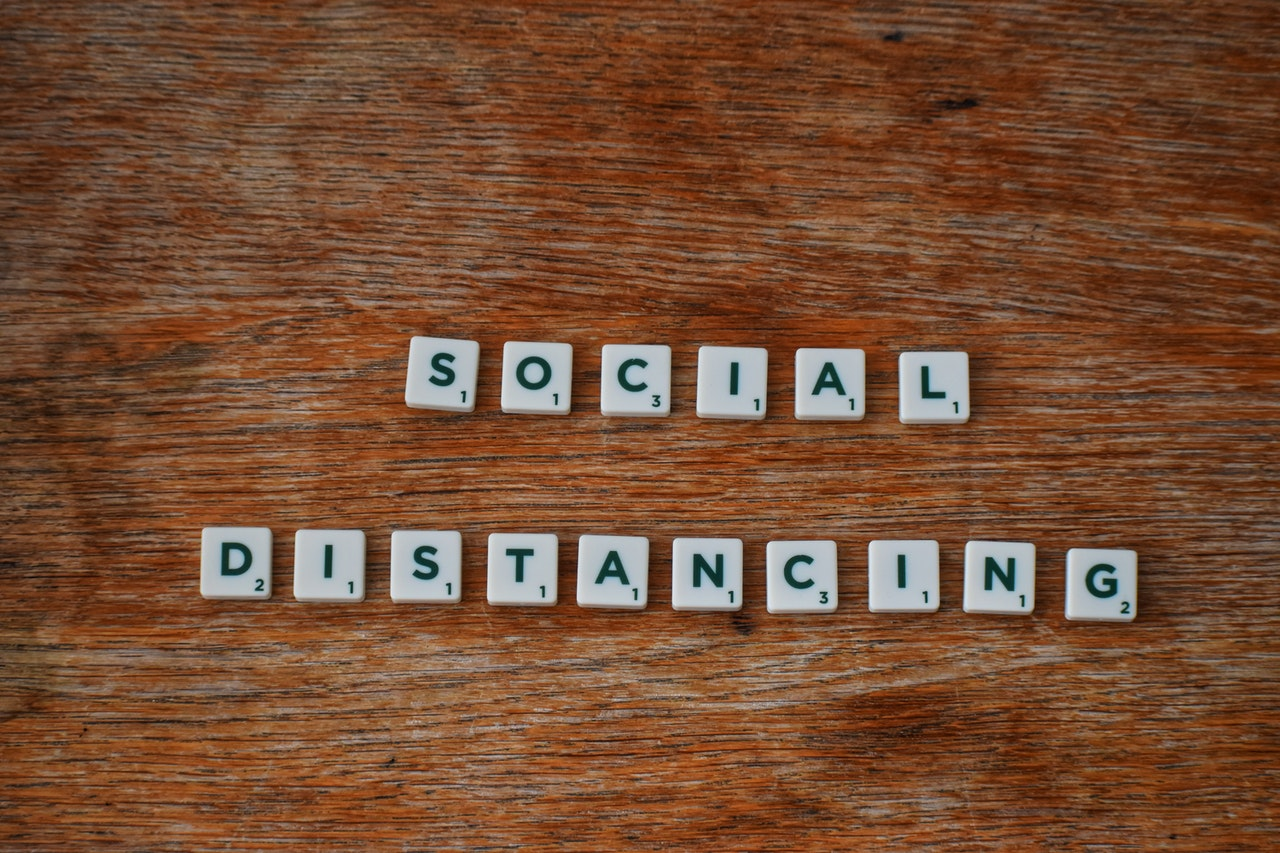 social-distancing-on-wooden-table-3988876